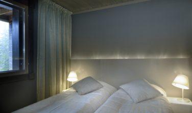 Luxusní srubový dům KONTIO ložnice v suterénu